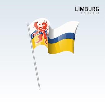 Wehende flagge der provinzen limburg der niederlande auf grauem hintergrund isoliert