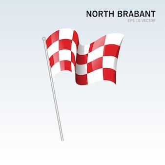 Wehende flagge der provinzen nordbrabant der niederlande isoliert auf grauem hintergrund Premium Vektoren