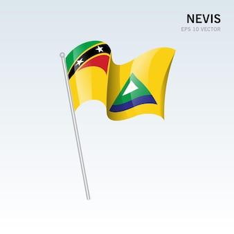 Wehende flagge von nevis von st. kitts und nevis isoliert auf grauem hintergrund