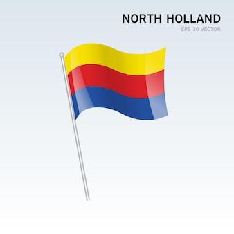 Wehende flagge von nordholland-provinzen der niederlande isoliert auf grauem hintergrund Premium Vektoren