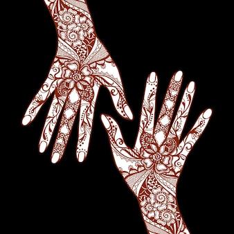 Weibliche hände bedeckt mit traditionellen indischen mehendi henna tattoo ornamenten