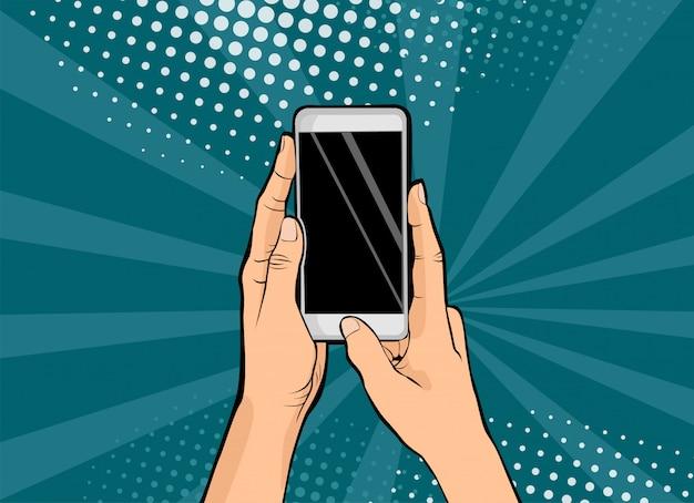Weibliche hände der pop-art, die smartphonepop-art halten