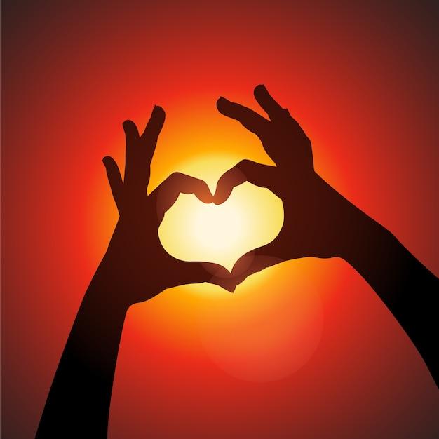 Weibliche hände machen zeichen herz durch finger auf sonnenuntergang hintergrund liebeskonzept am valentinstag