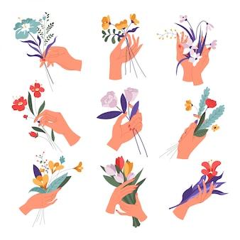 Weibliche hand, die blumenstrauß in blüte gesetzt hält