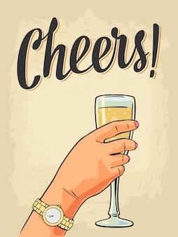 Weibliche hand, die ein glas champagner hält.