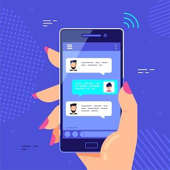 Weibliche hand, die smartphone hält, online-chat-sprechblasen. handy messenger, internet-technologien
