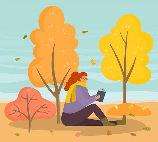 Weibliche leseliteratur in autumn park