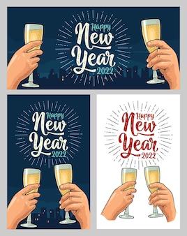 Weibliche und männliche hände, die mit zwei gläsern champagner halten und klirren