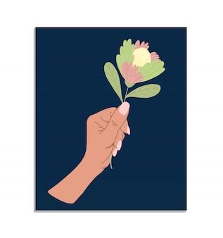 Weibliche zarte hand hält eine blume. hand gezeichnete farbige trendige illustration. dekoratives gestaltungselement auf einem stoff, geburtstagskarte. das konzept des feminismus und der unabhängigkeit der frauen.