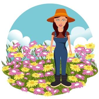 Weiblicher landwirt auf dem blumenfeld