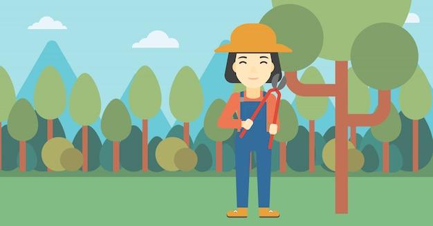 Weiblicher landwirt, der gartenschere verwendet
