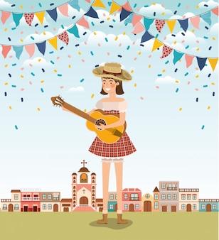 Weiblicher landwirt, der gitarre mit girlanden und stadtbild spielt