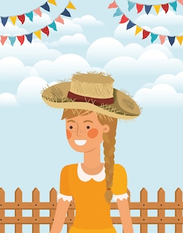 Weiblicher landwirt, der mit girlanden und zaun feiert