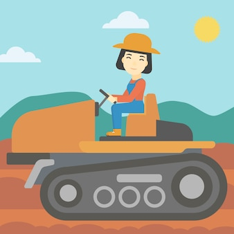 Weiblicher landwirt, der traktor fährt