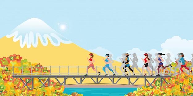 Weiblicher marathonläufer, der im herbst auf brücke läuft.