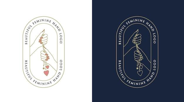 Weibliches schönheits-boho-logo mit frauenhandnagelherz für make-up-salon-spa