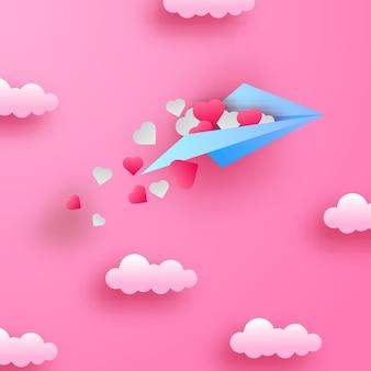 Weiche pastellliebesromantikdekoration der valentinstaggrußkarte mit papierschnittart des fliegenden papierflugzeugs auf dem rosa himmel mit wolken