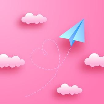 Weiche pastellliebesromantikdekoration der valentinstaggrußkarte mit papierschnittart des fliegenden papierflugzeugs auf dem rosa himmel mit wolken Premium Vektoren