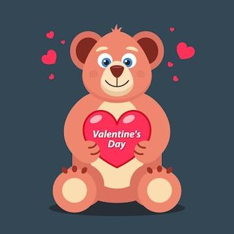 Weicher teddybär mit herz im pfotenbanner zum valentinstag