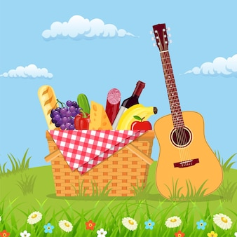 Weiden-picknickkorb voller produkte Premium Vektoren