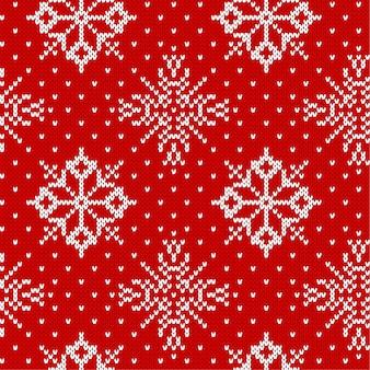 Weihnachten, das nahtloses muster mit schneeflocken strickt. gestricktes rotes strickjackendesign. traditionelles gestricktes dekoratives muster