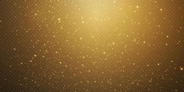 Weihnachten fallen goldene lichter. magischer abstrakter goldstaub und blendung. festlicher weihnachtshintergrund. abstrakte goldene teilchen und glitzer auf einem schwarzen hintergrund.