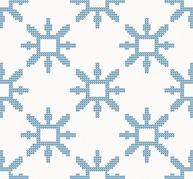 Weihnachten gestricktes nahtloses muster mit blauen schneeflocken