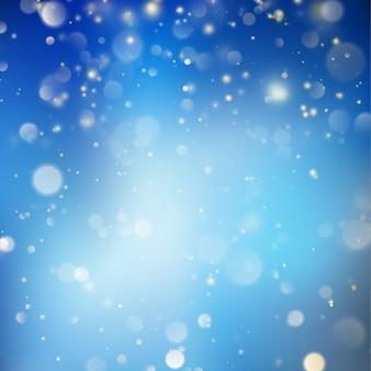 Weihnachten leuchtende blaue vorlage. weihnachtsbeleuchtung. blauer neujahrs-abstrakter glitterdefokussierter hintergrund mit blinkenden sternen und funken. verschwommenes bokeh. und beinhaltet auch