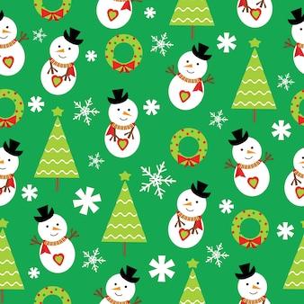 Weihnachten nahtlose muster von schneemann und weihnachtsbaum auf grünem hintergrund