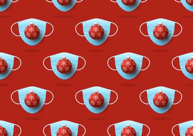 Weihnachten nahtloses muster von medizinischen gesichtsmasken und weihnachtsball