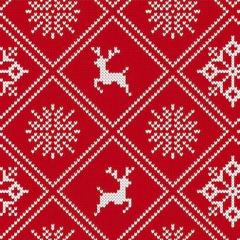 Weihnachten strickte geometrische verzierung mit elchen und schneeflocken. gestrickter nahtloser hintergrund. strickmuster