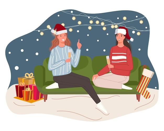 Weihnachten und happy new year feiern winterferien zwei frauen sitzen zusammen auf dem sofa
