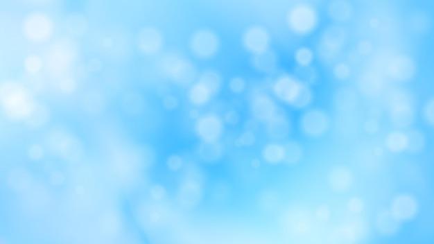 Weihnachten und neujahr winter verschneiten unscharfen hintergrund abstrakter blauer kreisförmiger bokeh-hintergrund