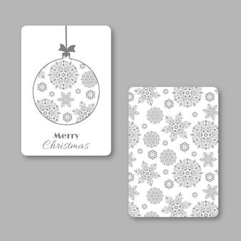 Weihnachts- und neujahrs-visitenkarte mit weihnachtsschneeflockenball. weiße und graue farben, dekorativer vintage-stil. vektor-illustration.