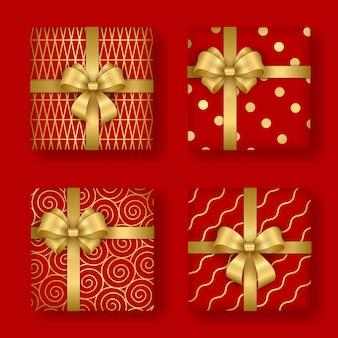 Weihnachts- und neujahrsdesign set aus realistischroten geschenkboxen mit goldenen ornamenten und schleife
