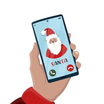 Weihnachtsanruf vom weihnachtsmann mit gruß weihnachten und guten rutsch ins neue jahr. smartphone in der hand.