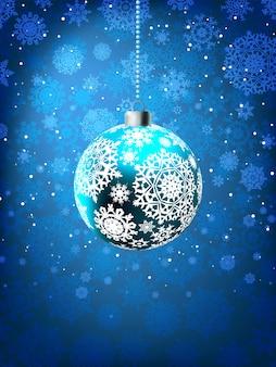 Weihnachtsball auf fallender flockenschablone.