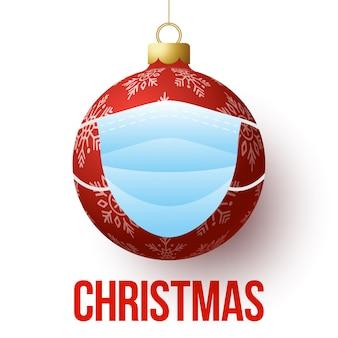 Weihnachtsball mit gesichtsmaske