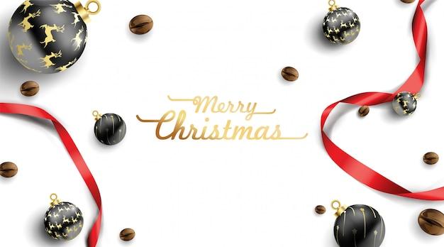 Weihnachtsball und kaffeebohnedekorationsansicht von oben genanntem mit rotem band um karte