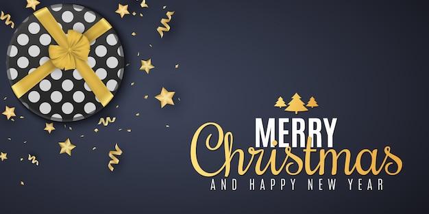 Weihnachtsbanner. goldene sterne mit konfetti und serpentin. geschenkbox mit schleife. stilvoller schriftzug. grußkarte.