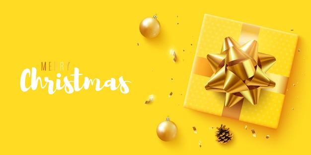 Weihnachtsbanner. mit realistischer geschenkbox, glitzerndem goldkonfetti. horizontal