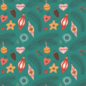 Weihnachtsbaumspielzeug mit fichtenzweigen im flachen stil auf grünem hintergrund, nahtloses vektormuster.