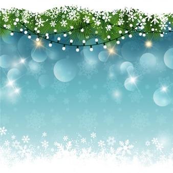 Weihnachtsbeleuchtung an einem verschneiten hintergrund bokeh