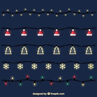 Weihnachtsbeleuchtung auf dunklem hintergrund