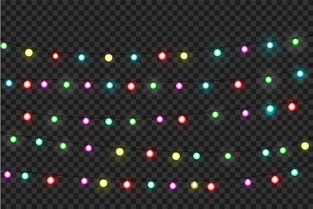 Weihnachtsbeleuchtung. bunte helle weihnachtsgirlande. farben girlanden, rote, gelbe, blaue und grüne glühbirnen. neon beleuchtete leds auf transparentem hintergrund.
