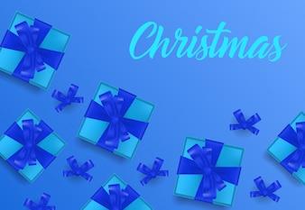 Weihnachtsbeschriftung auf blauem Hintergrund mit Geschenkboxen