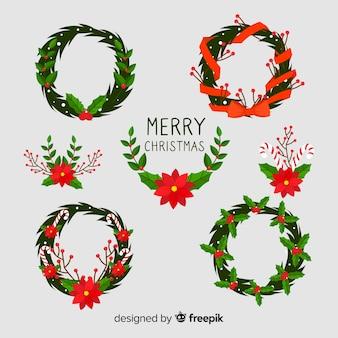 Weihnachtsblumen- und -kranzansammlung im flachen design