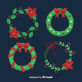 Weihnachtsblumen- und -kranzansammlung
