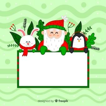 Weihnachtscharakter, der weiße leere karte anhält