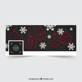 Weihnachtsdeckel mit kugeln und schneeflocken